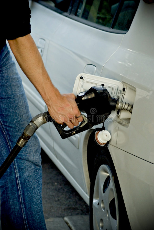 Man pumping gas into car stock images
