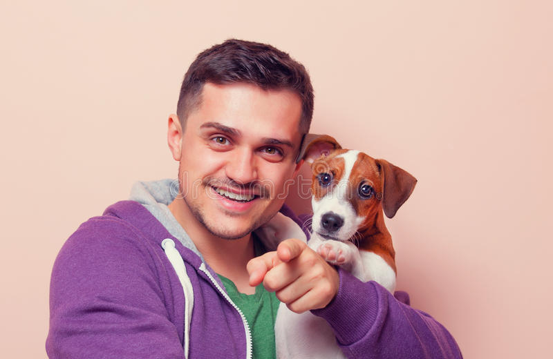 Man with puppy stock photo