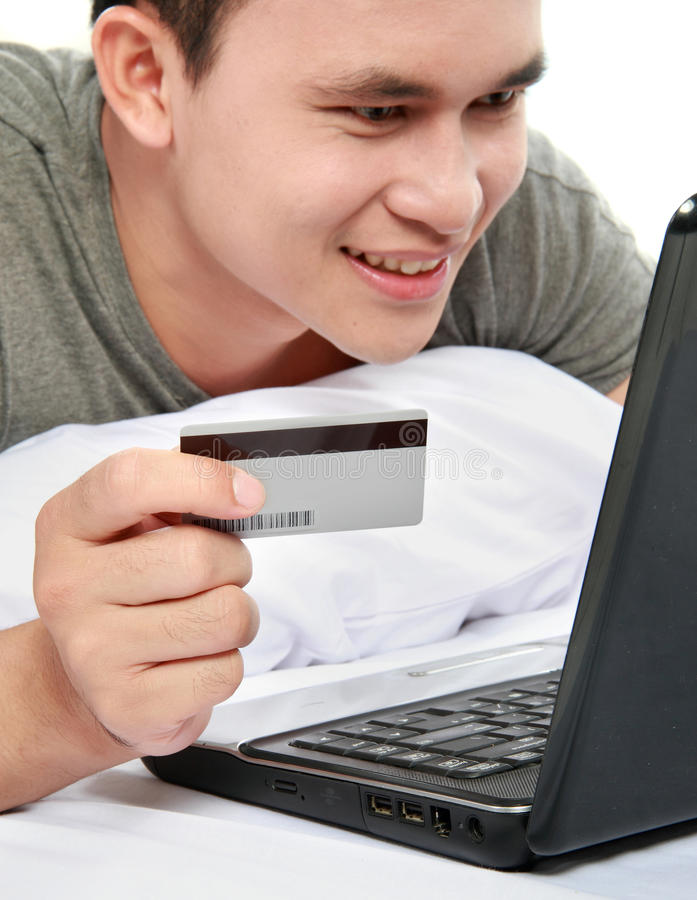 Man Purchasing Online Using Credit Card Royalty Free Stock Photo