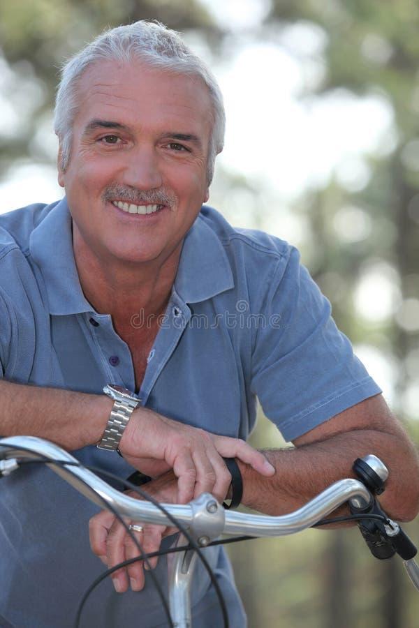 Download Man with push bike stock image. Image of bicycling, flora - 22884701