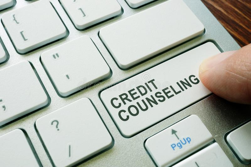Man pushing button credit counseling. Debt advice royalty free stock image