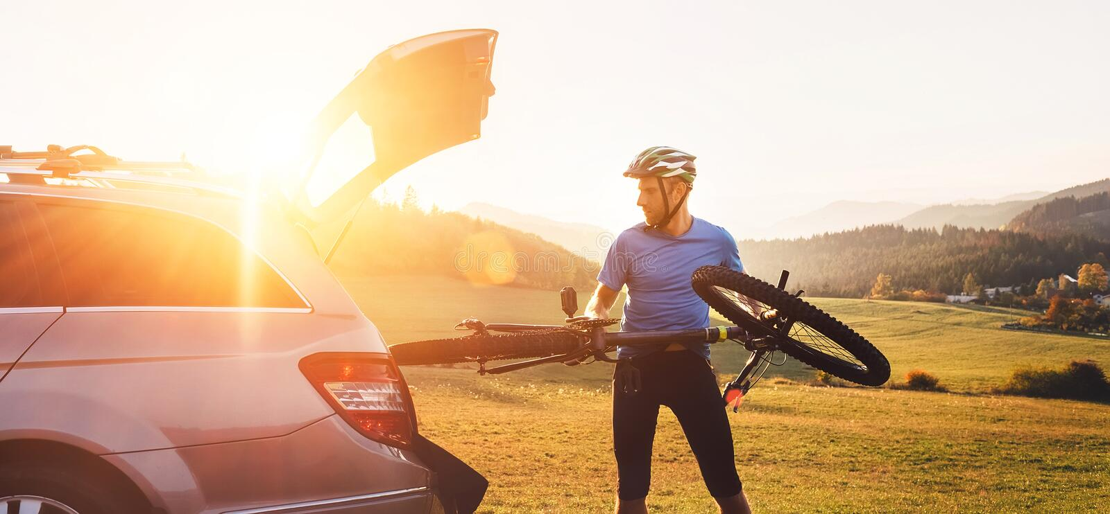 Man put his bicycle in the trunk of a car opt fl stock images