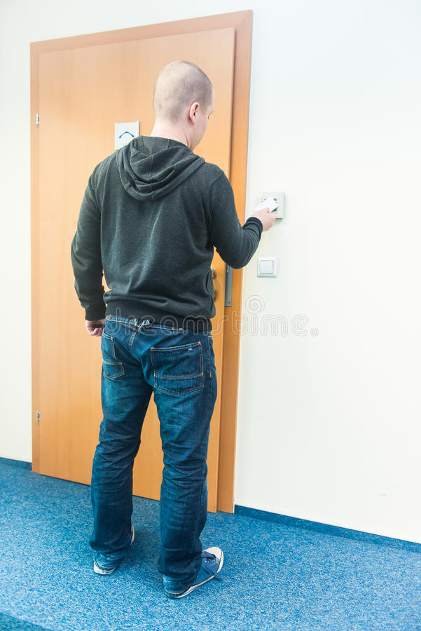 Man puts the card into the reader access control. Office royalty free stock image