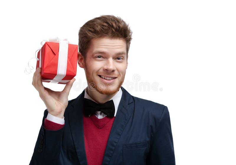 Man puts his ear to present stock photos