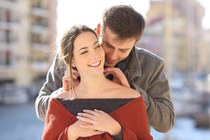 Man putting a blank jewel to his girlfriend stock images