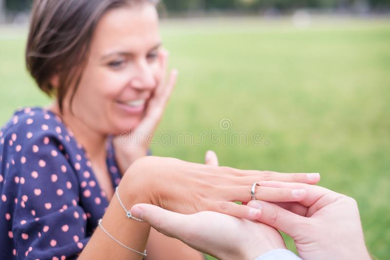 Man putting a engagement ring after proposal outdoor royalty free stock photos