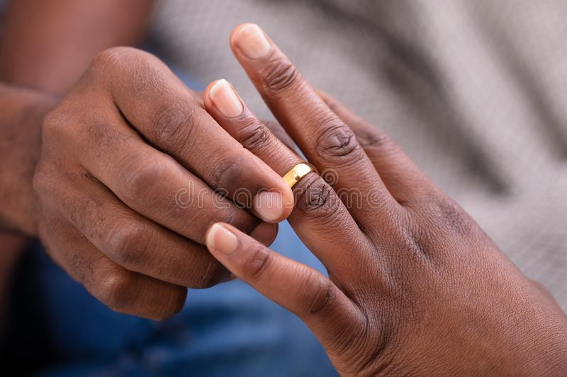 Man Putting An Engagement Ring On Woman`s Finger stock image