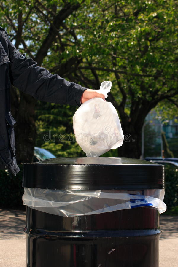 Free Man Putting Garbage In A Can Royalty Free Stock Photos - 9502478