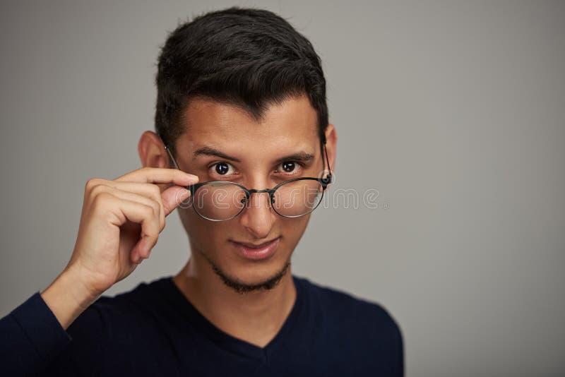 Man putting glasses down stock photos