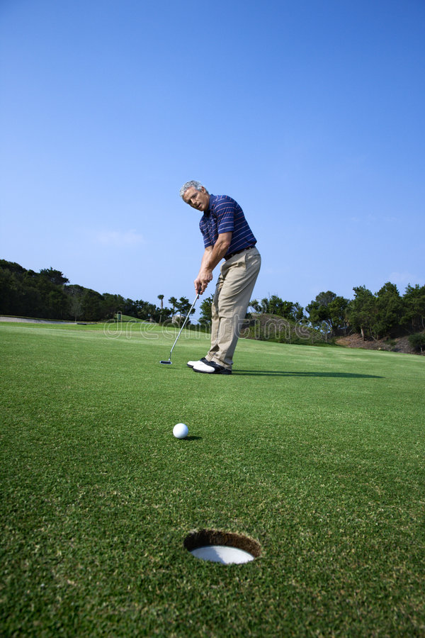Download Man Putting At Golf Course. Stock Image - Image: 2051793