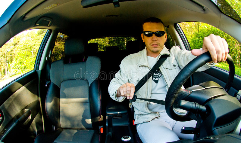 Man Putting his Seatbelt On stock photography