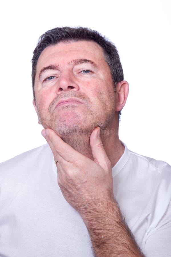 Man Putting Looking Beard Royalty Free Stock Image