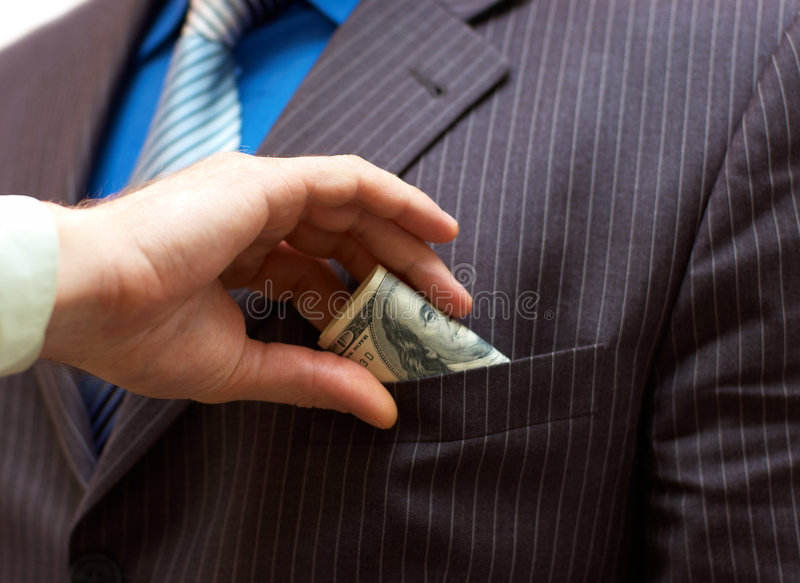 Download Man Putting Money Into Suit Pocket Stock Photo - Image: 7936230