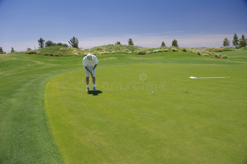 Download Man Putting With Mountains Royalty Free Stock Photos - Image: 7893178