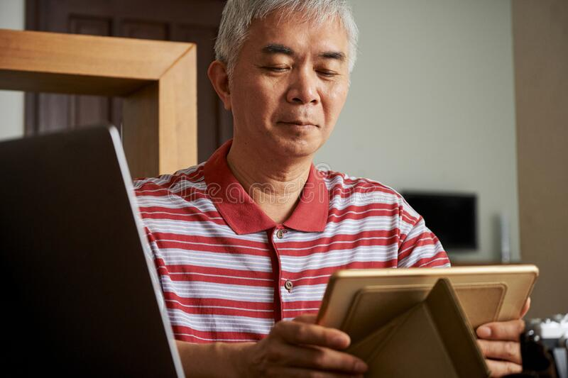 Man putting tablet on stand royalty free stock photography