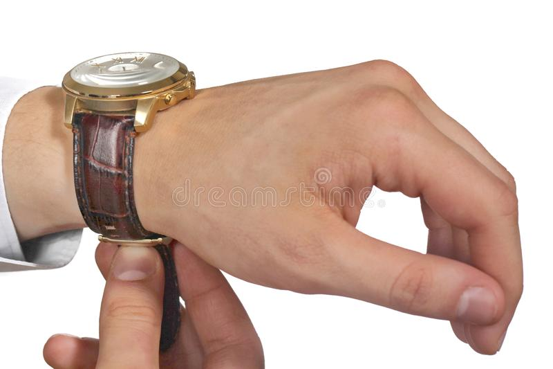 Man putting on wrist watch. Isoalted on black background. Shallow focus stock image