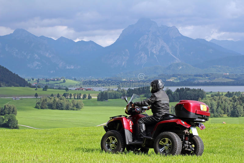 Download A Man On Quad Before The Mountains In Bavaria Stock Photo - Image: 26786736