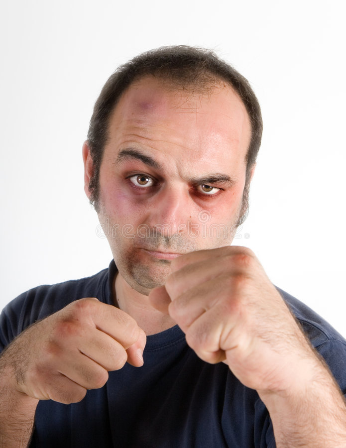 Man with raised fists. Man with raised fists as if ready for a fight stock photo