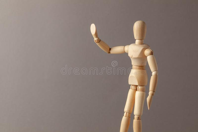 Man raised his hand up symbolizing the STOP signal on a gray background. Copy space for text. Man raised his hand up symbolizing the STOP signal on a gray royalty free stock photo