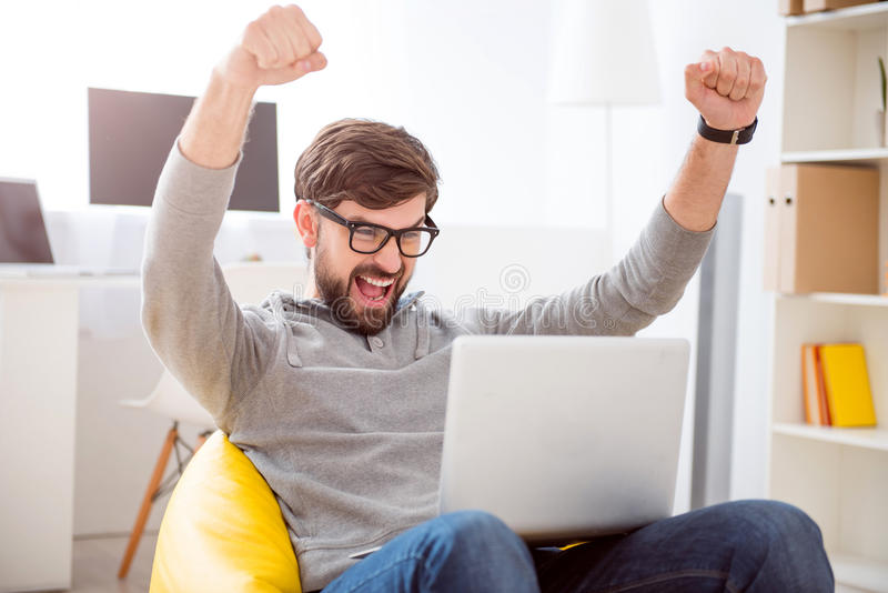 Man raising hands in sign of victory stock images
