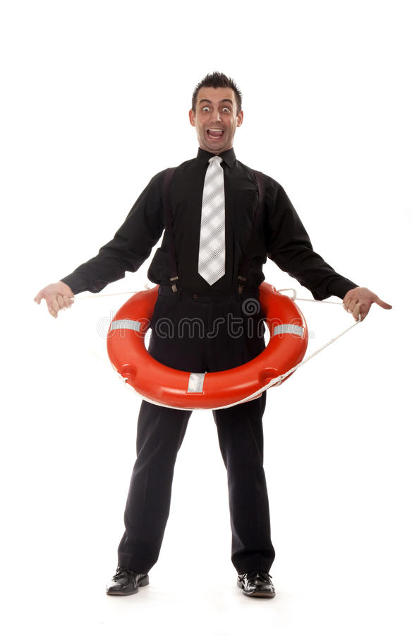 Man reaching for lifebuoy. Funny young man holding lifebuoy royalty free stock images