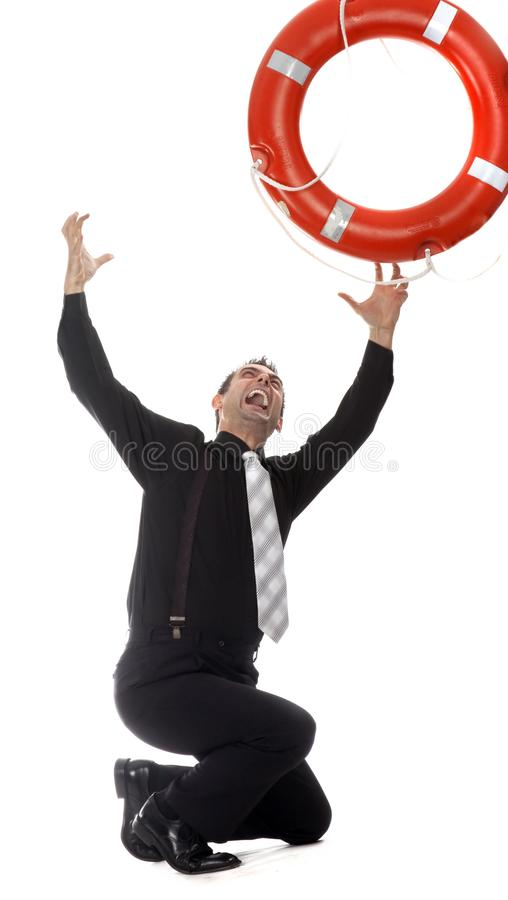Man reaching for lifebuoy stock photography
