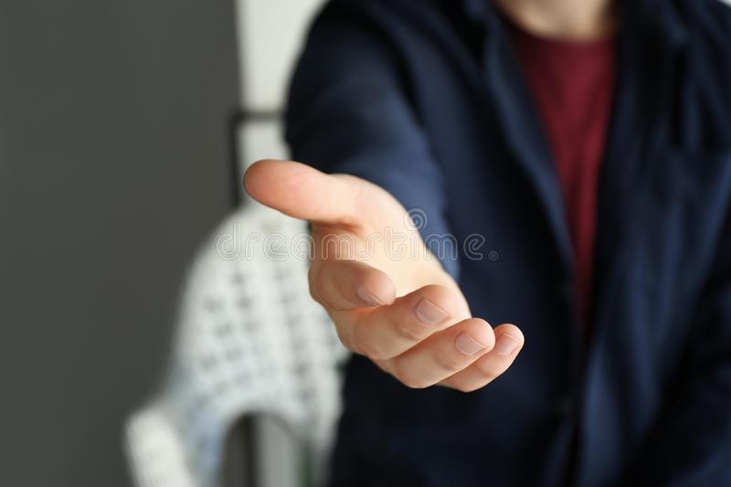 Man reaching out for handshake, closeup royalty free stock photo