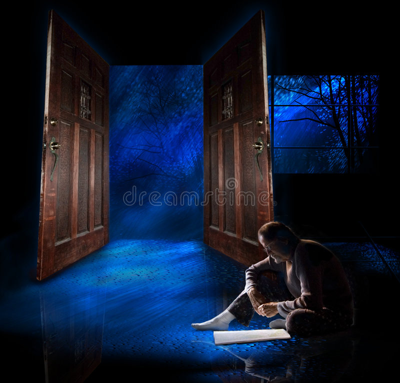 Man reading. A older mature man sits on a wet floor reading a map. The room he is in is dark and filled with water as a storm swirls outside. He is lost royalty free stock photos