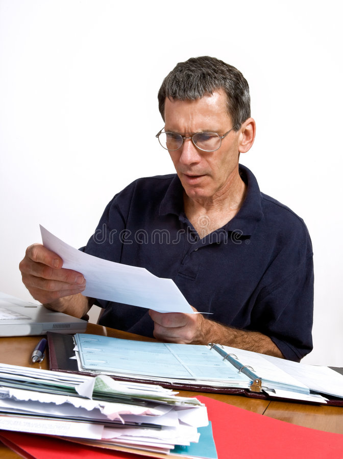 Free Man Reading A Bill In Shock And Disbelief Stock Images - 6167264