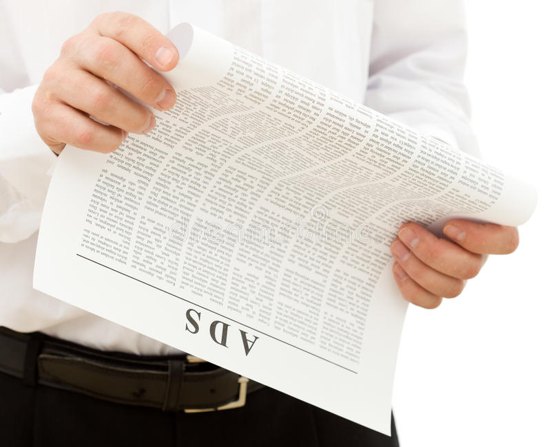 Download Man Reading Ads From The Paper Stock Images - Image: 13418144