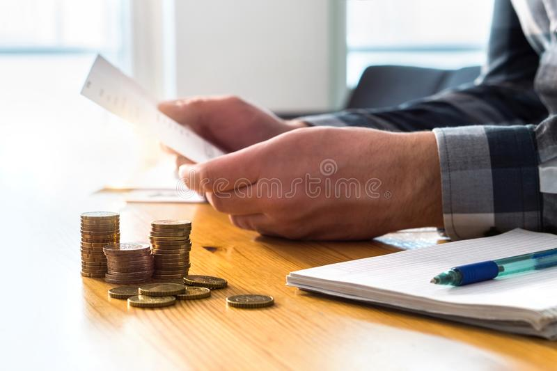 Man reading bank statement, check reminder, tax refund document. royalty free stock photo