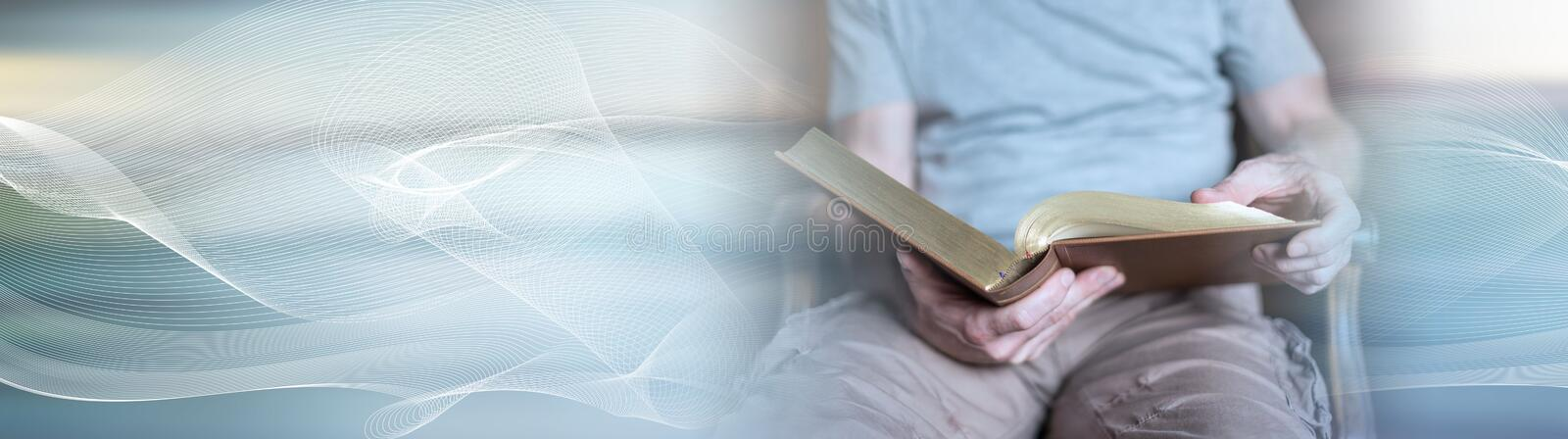 Man reading the bible. panoramic banner royalty free stock photography
