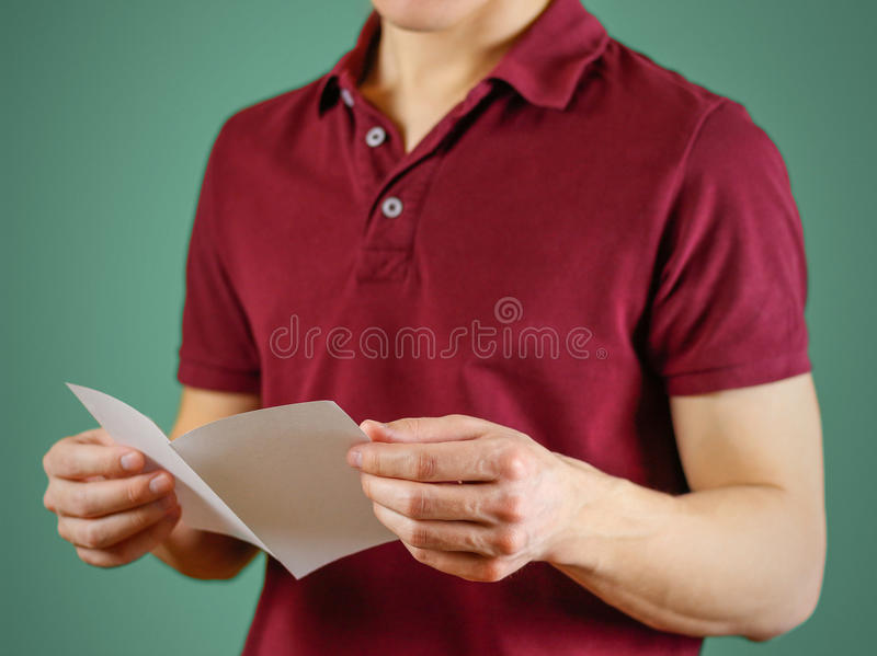 Man reading blank white flyer brochure. Read detailed booklet. L. Eaflet presentation. Pamphlet hold hands. Man show clear offset paper. Sheet template. Booklet royalty free stock photo