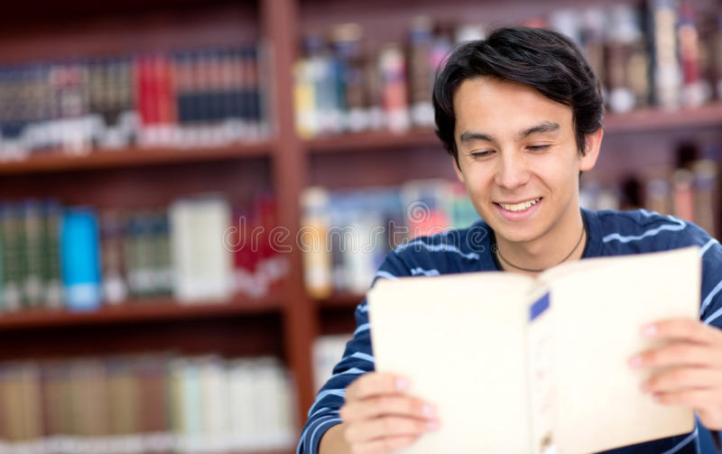 Download Man reading a book stock image. Image of college, joyful - 25650017