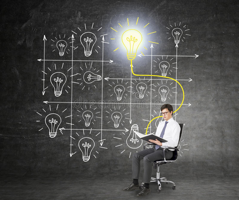 Man reading a book. A businessman sitting on a castor chair and reading a book, system of bulbs drawn behind him, the book and the shining yellow bulb linked royalty free stock photos