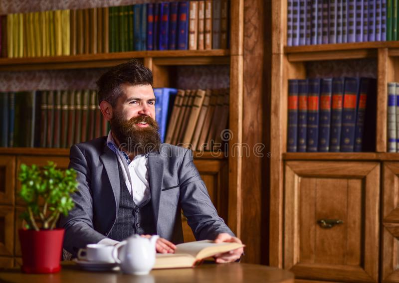 Man reading book and drinking coffee royalty free stock images