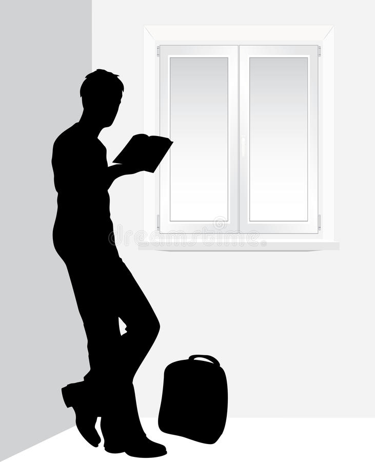 Man reading a book near the window stock images