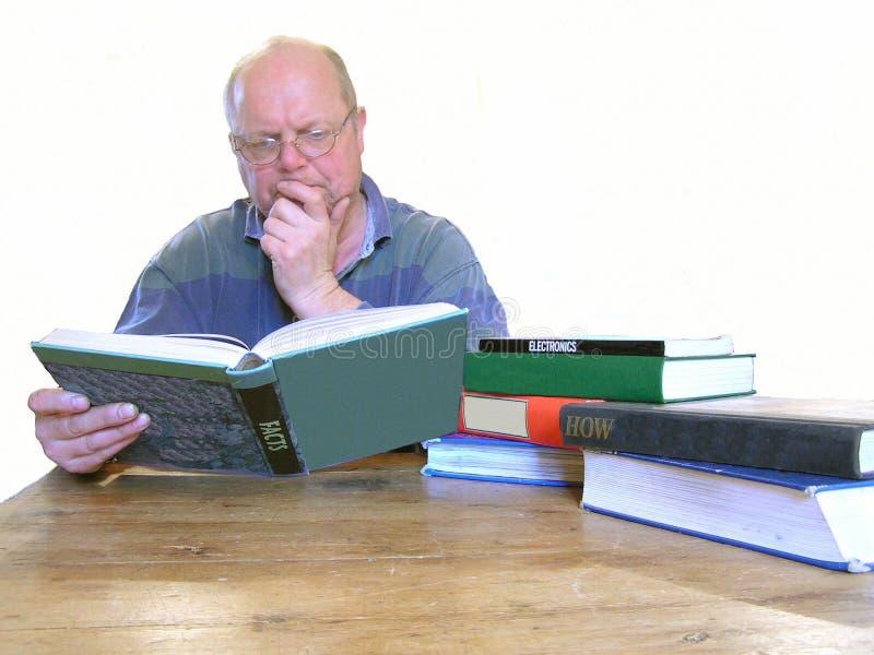 A man reading books royalty free stock photos