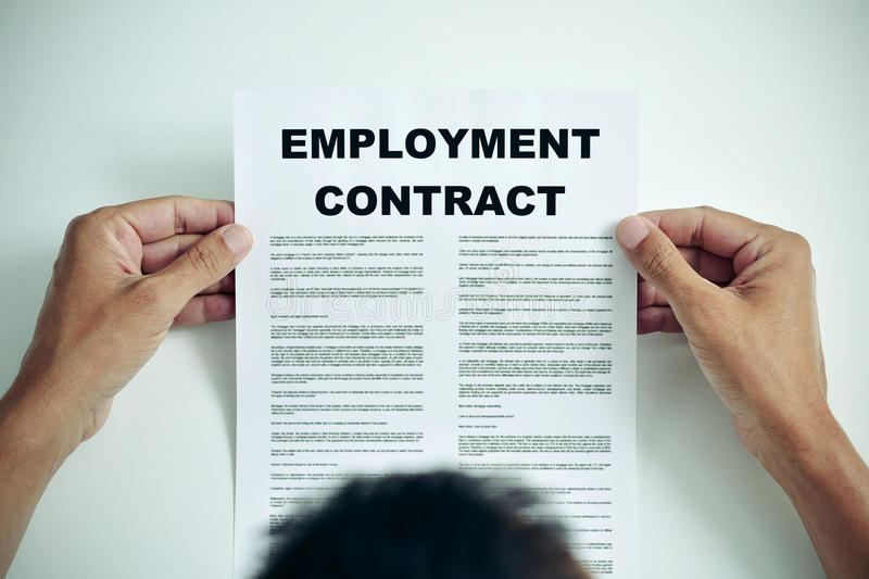 Man reading an employment contract stock images
