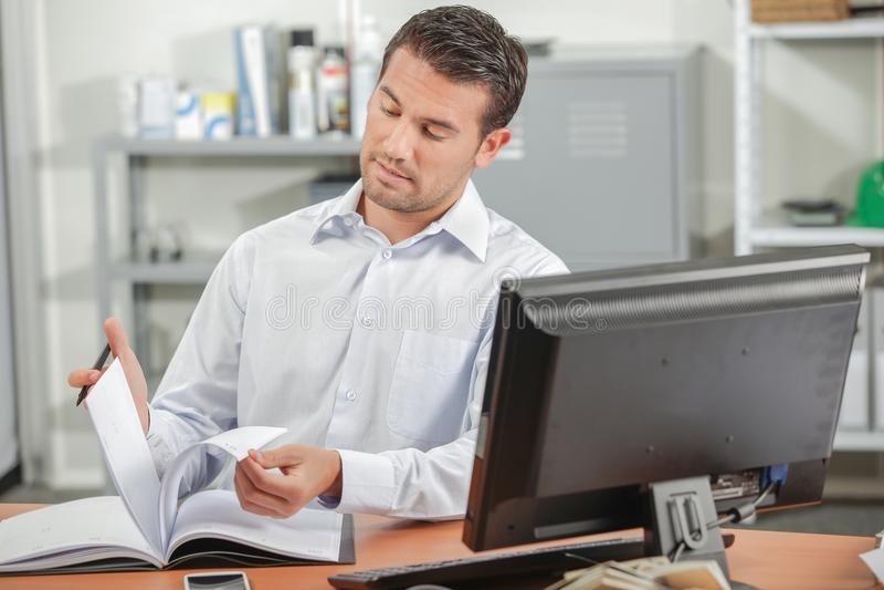 Man reading at desk royalty free stock image