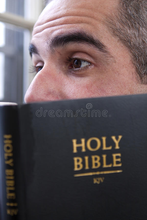 Man reading the Holy Bible stock photo