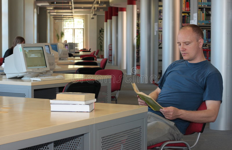 Download Man reading in the library stock image. Image of column - 5353261