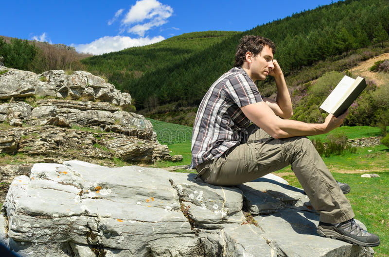 Man reading in nature royalty free stock photo