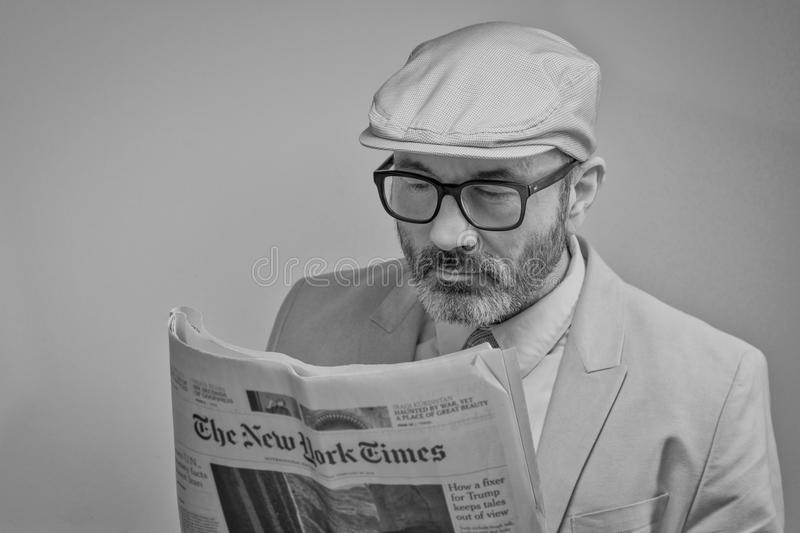 Man Reading a Newspaper stock images