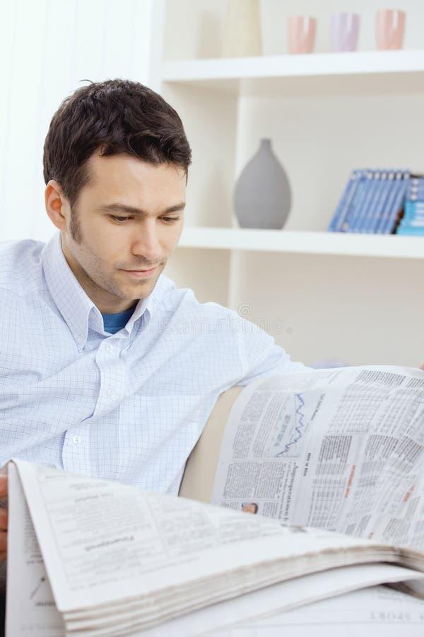 Man reading newspaper royalty free stock photo