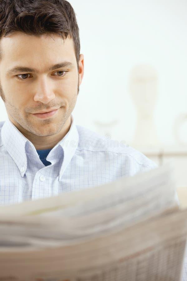 Man reading newspaper royalty free stock photos