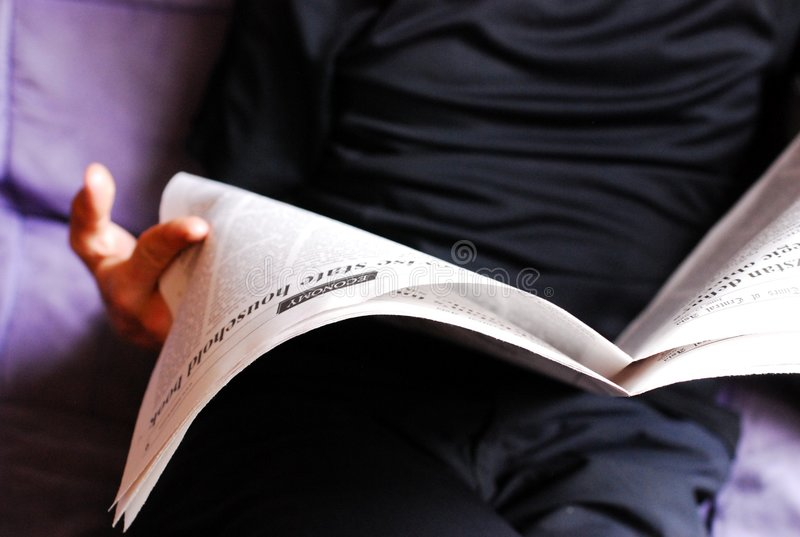 Download Man reading a newspaper stock image. Image of closeup - 5575963