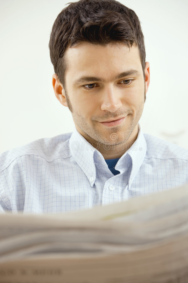 Man reading newspaper stock images