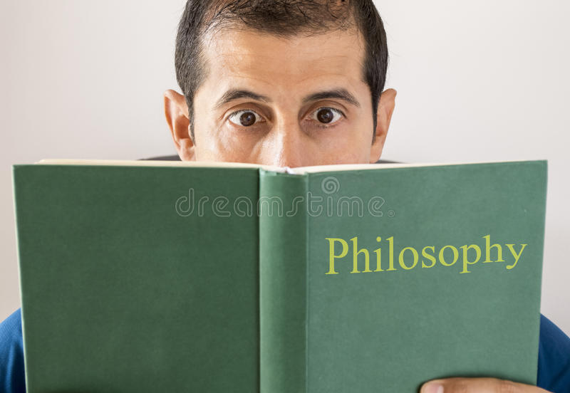 Man reading philosophy royalty free stock photography