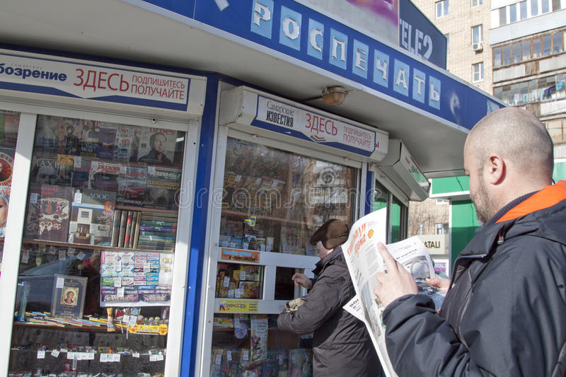 Man is reading the Russian newspaper. Russian news. A man is reading a newspaper. A man is buying a newspaper. What the Russian media say. What do the Russian stock photos